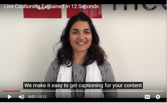 Finished captioned YouTube video with woman central in frame with ai-media logo in background